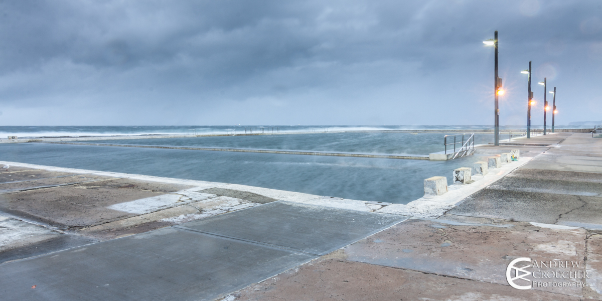 Stormy dawn at flat rock beach and newcastle ocean baths